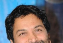 Who forced Trivikram Srinivas to come out from the hotel room?