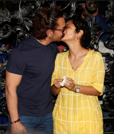 Aamir Khan and Kiran Rao share a passionate Kiss at Mumbai Airport