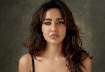 Chirutha actress Neha Sharma slut-shamed for flaunting her assets