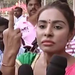 Sri Reddy abuse Pawan Kalyan using filthy language shows middle finger to Power Star Fans
