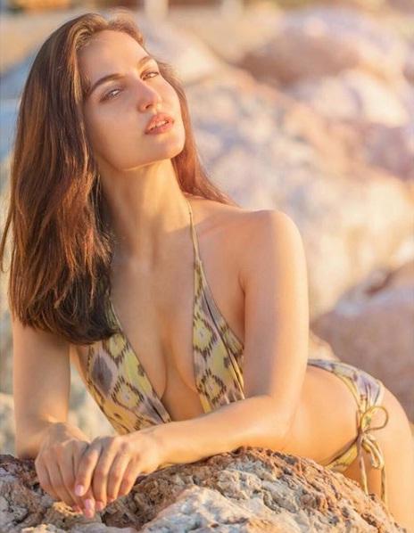 Elli Avram seductive pose in swimsuit