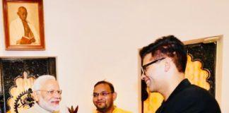 Baahubali presenter shakes Narendra Modi hand