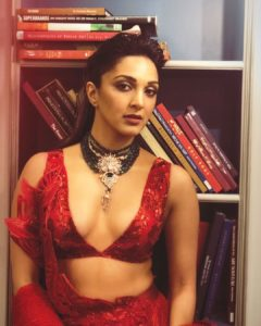 Lady Kabir flaunts major cleavage in bridal outfit