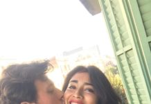 Husband kisses on the cheek of Shriya Saran