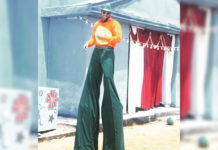 Rana Daggubati standing on circus stilts