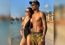 Newly engaged couple in Swim wear