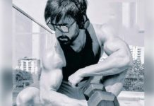 Ravi Teja flexes muscles using dumbbell
