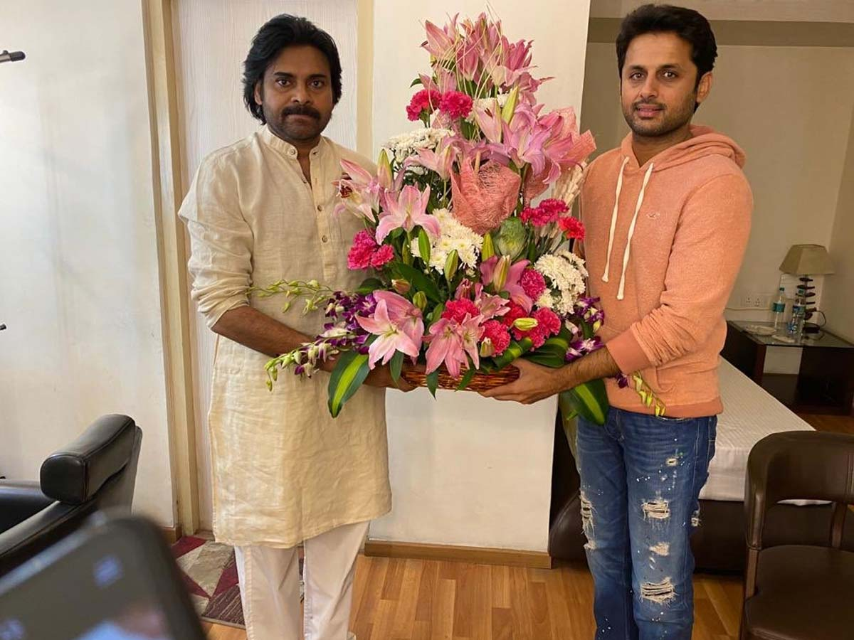 Pawan Kalyan presents flower bouquet to Nithiin