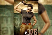 Nandita Swetha looking massy cop, holding gun in hand