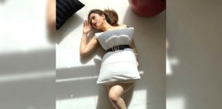 Tamannah uses pillow as dress, flaunts her Gucci belt