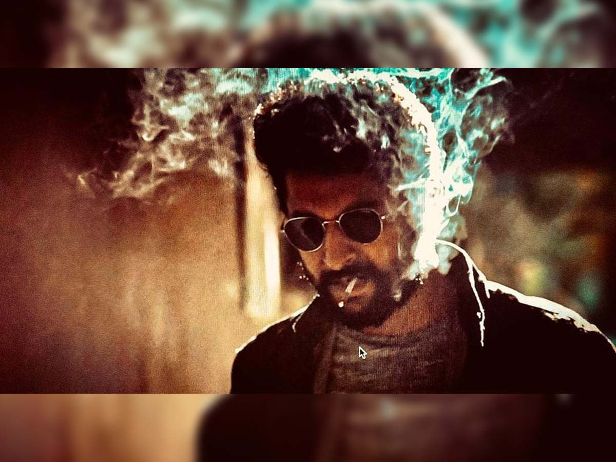 Nani glimpse from V: Sports rugged beard and smoking