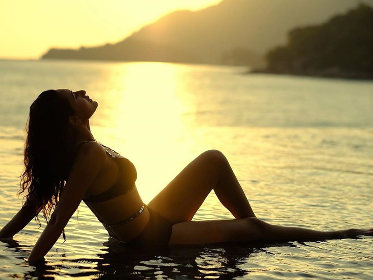 Bikini girl soaking in sunset