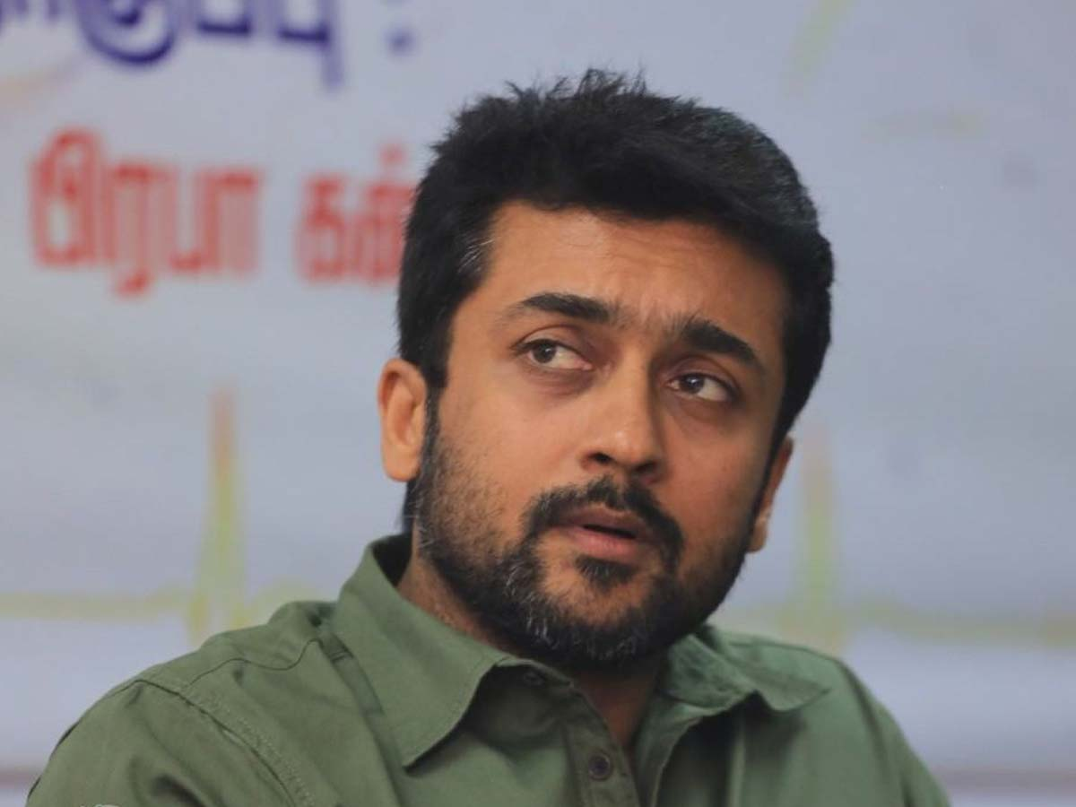 Protestors adorn Suriya pic with a garland of sandals