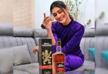 Payal Rajput with whisky bottle