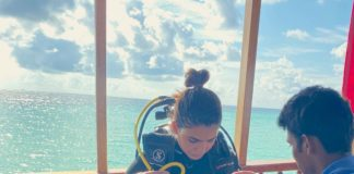 Samantha in scuba wear, ready to dives into the sea