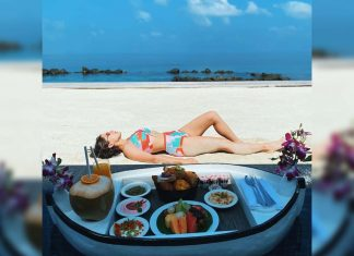 Bikini girl with floating breakfast, says : I will consume this entire boat