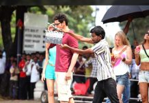 Buchi Babu Sana sounding clapboard for Mahesh Babu