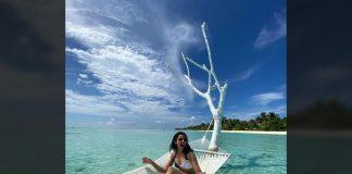 In bikini, She is chilling on a hammock