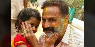 Balakrishna enjoying Holi color on his face