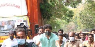 Vijay arrives on a bicycle to cast his vote