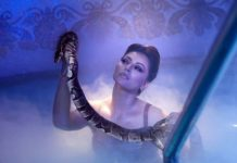 Bombshell Urvashi poses with Python in Pool